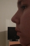 Side view. It feels like my nose is slightly upturned, because my nostrils show more than normal in front view. In front view my nostrils kind of hang below my nose instead of with it. If you look at angelina jolie's nose, her profile