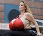 Chelsea Charms large breast implants