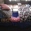 The bed with blankets and pillows to make it as comfortable as I need it to be...
