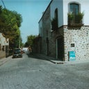 The streets in  San Miguel de Allende are all cobble stone, and the buildings are all painted beautiful southwest colors of golds, brick red, blue, yellows.